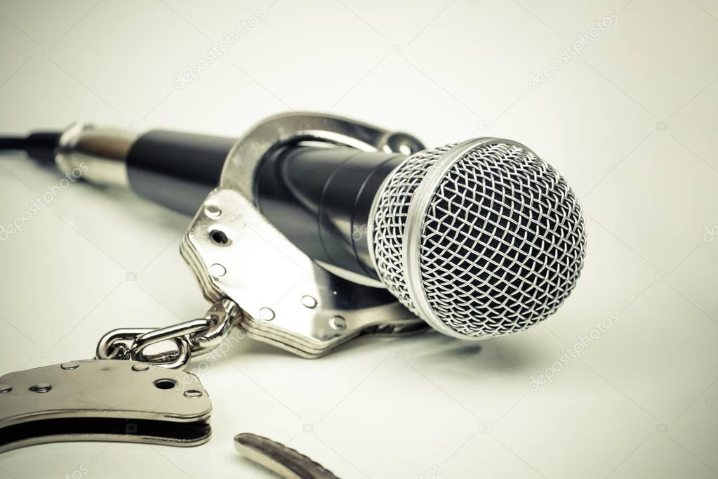 depositphotos 172517682 stock photo a microphone with handcuffs